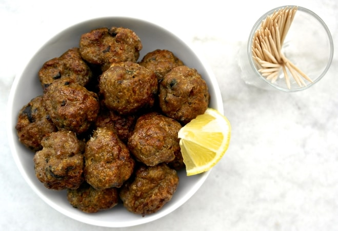 Juicy baked greek meatballs keftedakia olive tomato