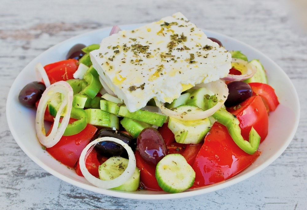 Photo of a Greek salad (tomatoes, cucumber, pepper, onion and olives) with feta cheese