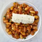 Greek white beans with tomato sauce and feta