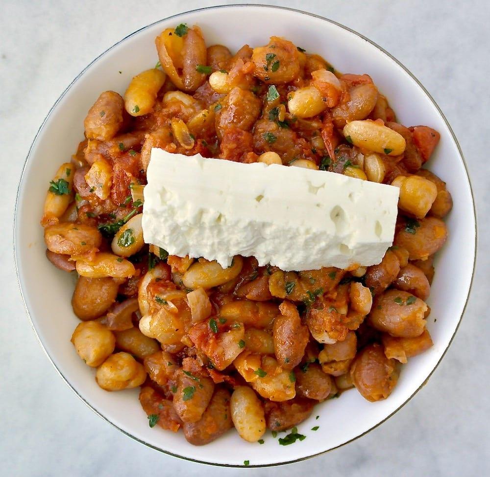 Greek white beans with tomato sauce and feta
