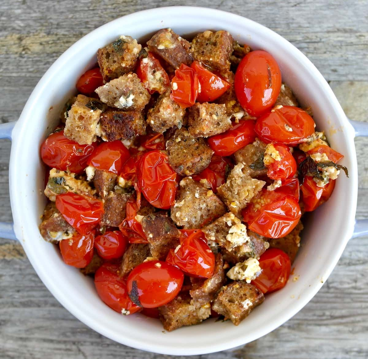 Roasted Cherry Tomatoes with Feta and Crispy Homemade Croutons.