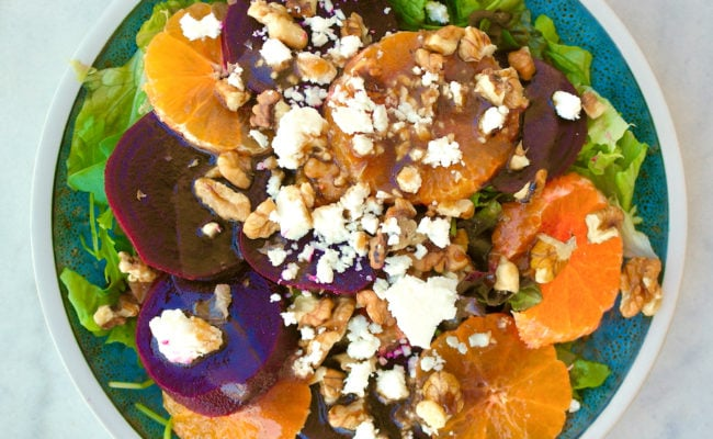 Beet salad with tangerines and feta on a plate