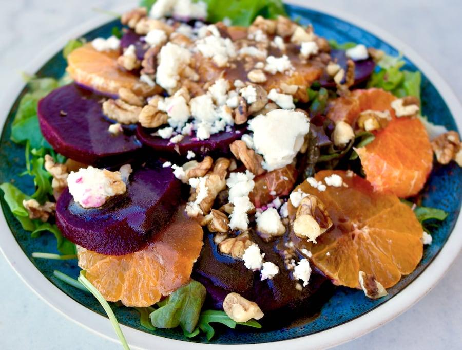 Mediterranean Beet salad with tangerines, greens and feta